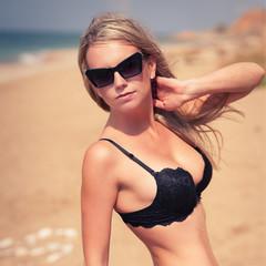 beautiful woman on the seashore sand