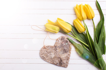 Background with fresh tulips and decorative heart