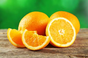Fresh orange fruit on grey wooden background