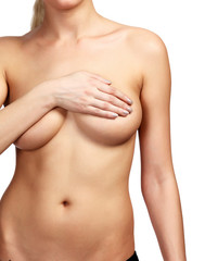 Woman covering her breast with her hands, white background