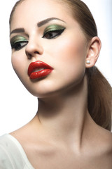 Beautiful woman with evening make-up, red lips. Beauty face. Picture taken in the studio on a white background.