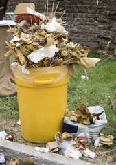Overfull garbage can trash in festival