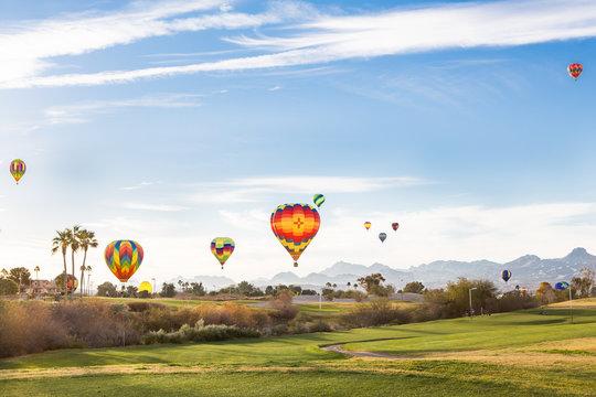 Hot Air Balloons Ascend over a golf course