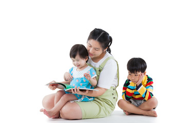 Mother with her child, girl read a book, son feel bad. Isolated