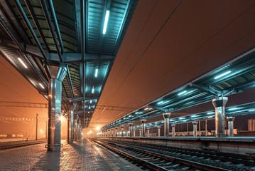 Aluminium Prints Train Station Railway station at night. Train platform in fog. Railroad