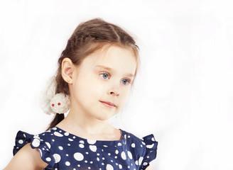 Little girl in a blue polka-dot dress with pigtails