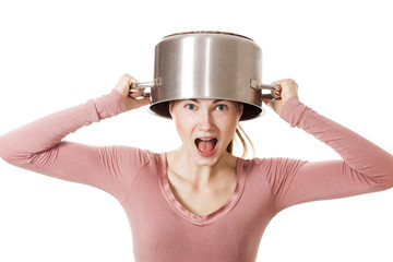 Screaming and funny girl portrait wearing soup pot as hat