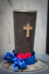 Patriotic flower holder cup for cemetery memorial.