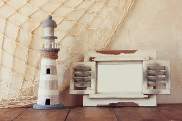 old vintage wooden white frame and lighthouse