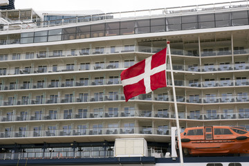 Danish flag and cruise boat