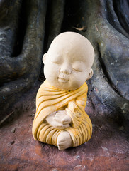 A child monk sculpture on meditation