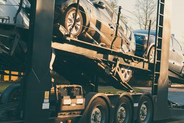 Car Transporter parked on road side vintage filter effect