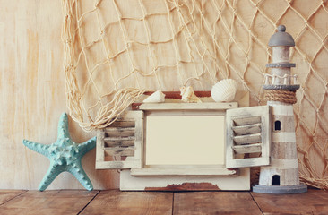 old vintage wooden white fram, starfish and lighthouse