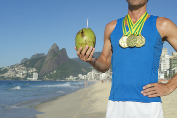 Gold Medal Olympic Athlete Celebrating with Coconut Rio