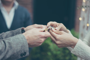 Bride and groom holding hands in vintage pastel colors