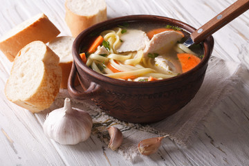 Chicken soup with noodles and vegetables, horizontal, rustic