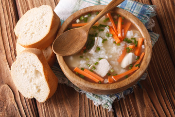 Rustic Food: rice soup in a wooden bowl. horizontal top view