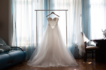 The perfect wedding dress with a full skirt on a hanger