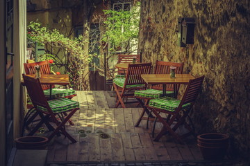 Homey outdoor cafe terrace in a shady place