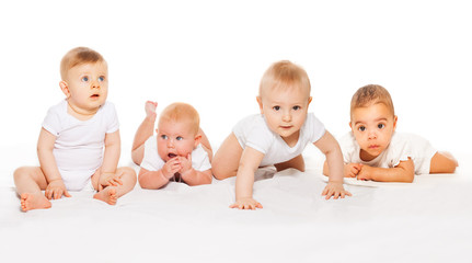 Cute babies crawl in a row wearing white bodysuit