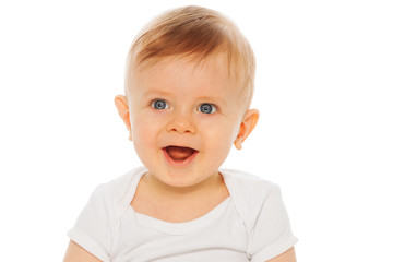 Portrait of nice laughing baby in white bodysuit