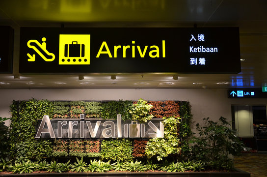 Directional sign in the Singapore Changi Airport.