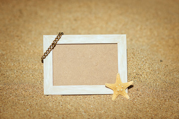 wooden picture frame on the beach