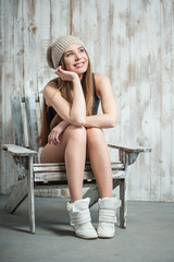 Beautiful hipster woman is sitting on the chair