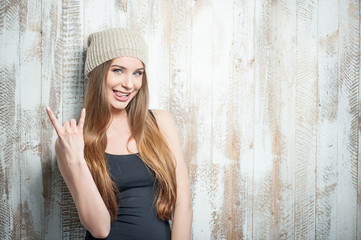 Cool hipster woman with nice hat is gesturing