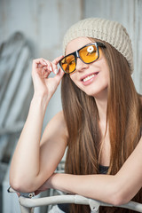 Pretty hipster woman with glasses and bicycle