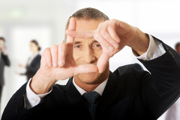 Businessman gesturing frame.