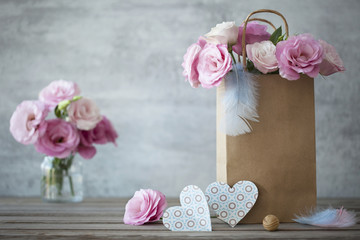 Romantic background with roses and paper hearts