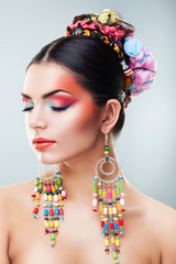 brunette girl with colourful earrings