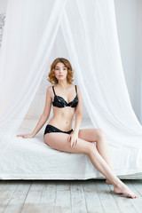 Attractive woman wearing black lingerie