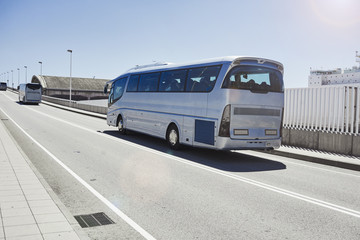 Tourist bus on the road highway with blue sky and sun
