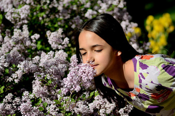 Little Hispanic Girl Stop to Smell the Flowers on a Spring Day