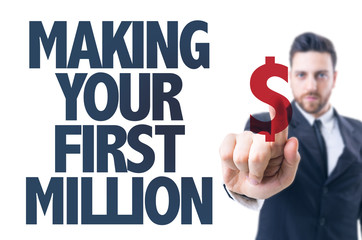 Business man pointing the text: Making Your First Million