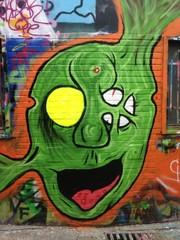 green graffiti face