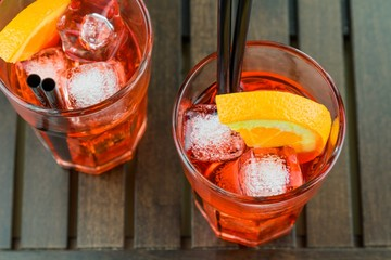 Fototapete - top of view of glasses of spritz aperitif aperol red cocktail