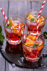 Red cool lemonade with oranges, soda, raspberry syrup, mint