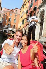 Travel - happy couple traveling in Venice gondola