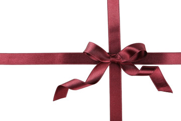 Burgundy ribbon with bow on white background