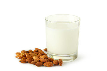 Glass of milk with almonds isolated on white