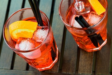 Fototapete - spritz aperitif aperol cocktail with orange slices and ice