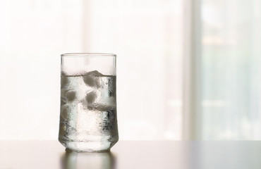 glass of Cool fresh drink with ice cube on the  table