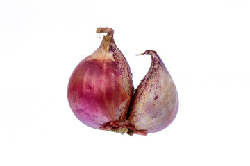 Thailand small red onion on a white background.