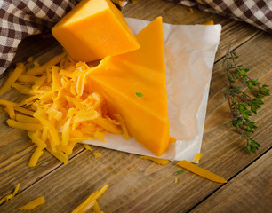 Cheese on  rustic wooden background.