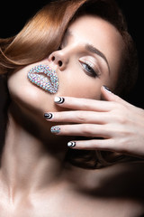 Beautiful girl with bright nails and lips of crystals, long