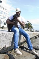 black man with dog