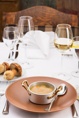 Serving plate with mushrooms and glasses of white wine